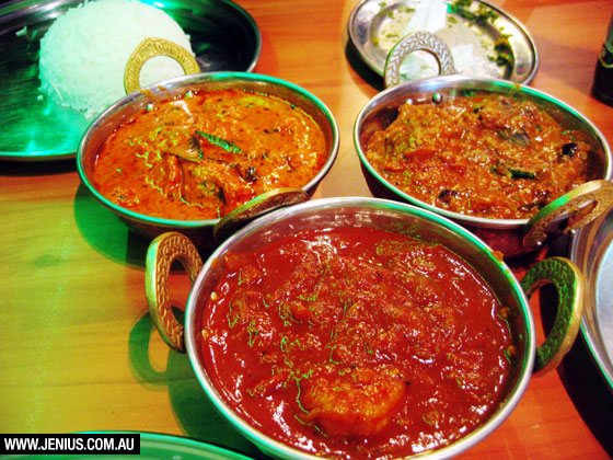 Kammadhenu Newtown - butter chicken curry with mild, sweet and creamy sauce, hot and tangy eggplant curry and prawn sambol