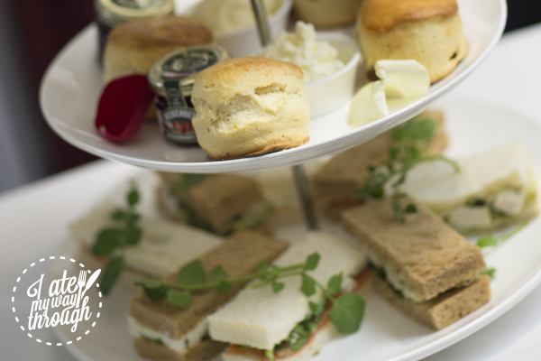 Tiered high tea service with a selection of ribbon chicanes prepared by Luke Mangan