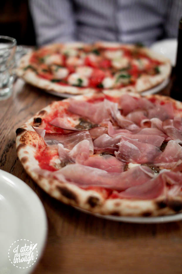 Speck e funghi trifolati: lightly smoked proscuitto scented with juniper berries and herbs, mixed sauteed mushrooms including porcini, fior di latte and organic tomato sauce