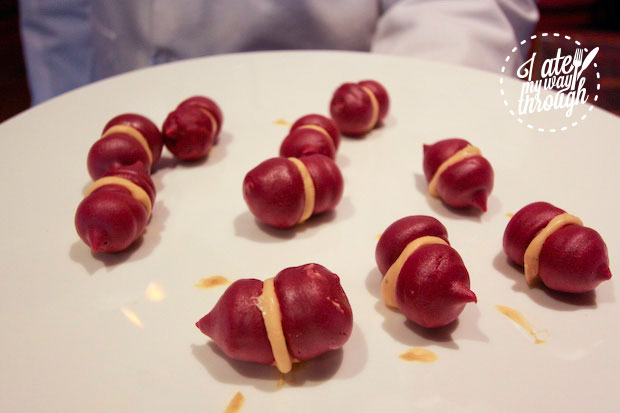 Beetroot macarons with foie gras on board Holland America Line ms Amsterdam