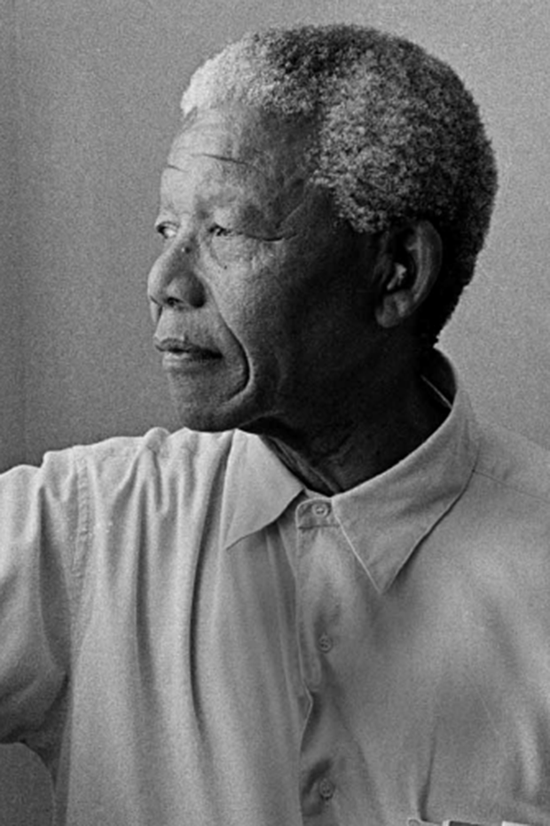 Nelson Mandela, looking pensively out a window