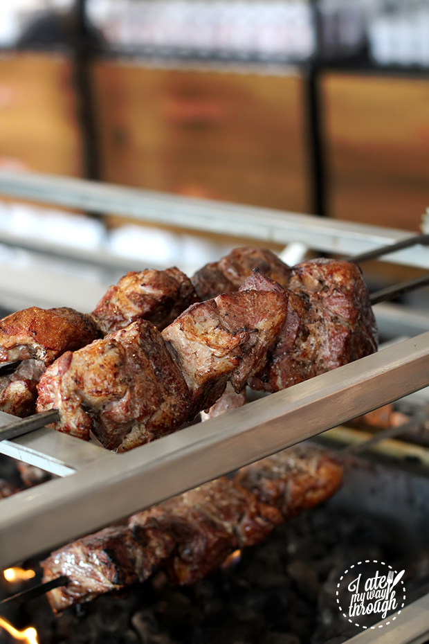 Knuckle sized pieces of lamb get barbecued over smoking lava rocks
