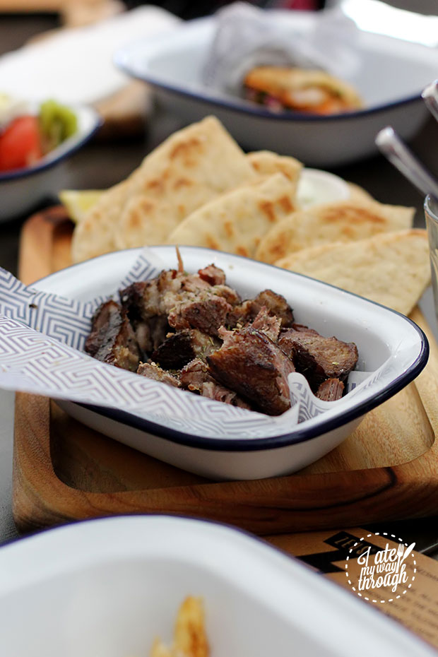 Succulent pieces of lamb slow cooked for 12 hours, then browned over lava rocks