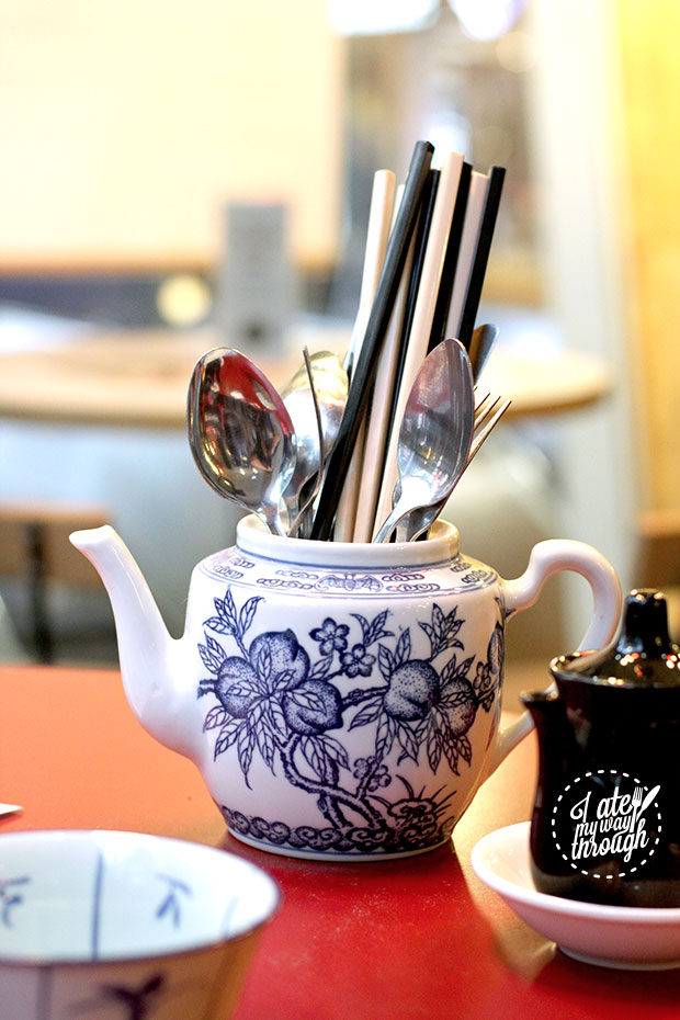 Utensils in a teapot as a holder