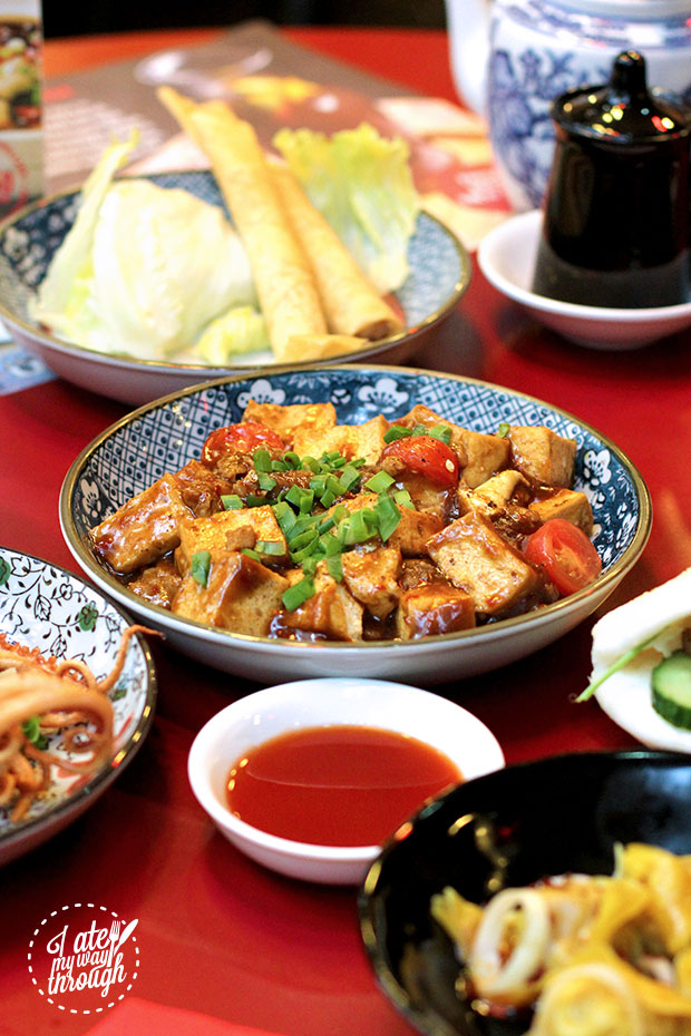 A flavour bomb of peppery tofu and diced chicken, served with cherry tomatoes and chilli