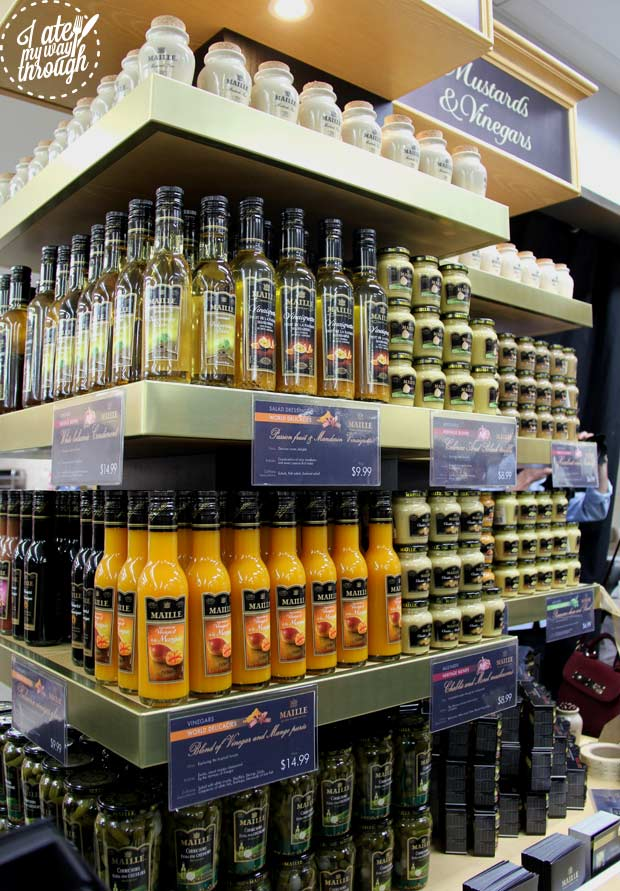 Selection of vinaigrettes and mustards on display in store
