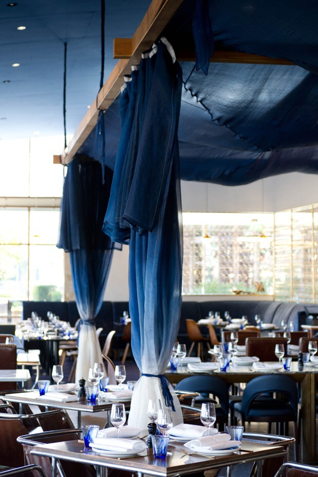 Blue drapes match the marine themed decor of Cafe Del Mar