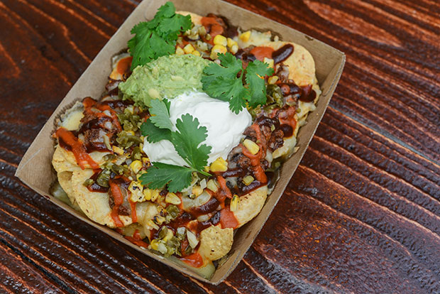 Cardboard tray filled with hot chilli nachos