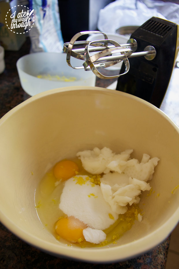 Eggs, coconut oil, rind and sugar ready to be mixed