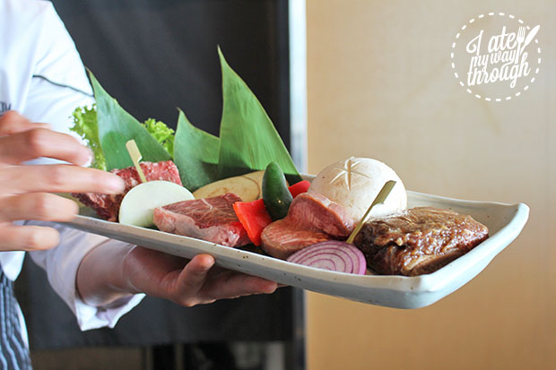 Head Chef James Son holding a plate of raw meat and vegetables