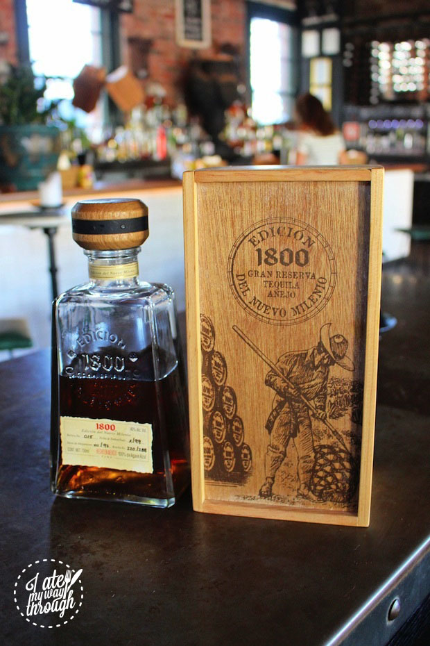 A bottle of 1800 Edicion del Nuevo Tequila alongside its protective box