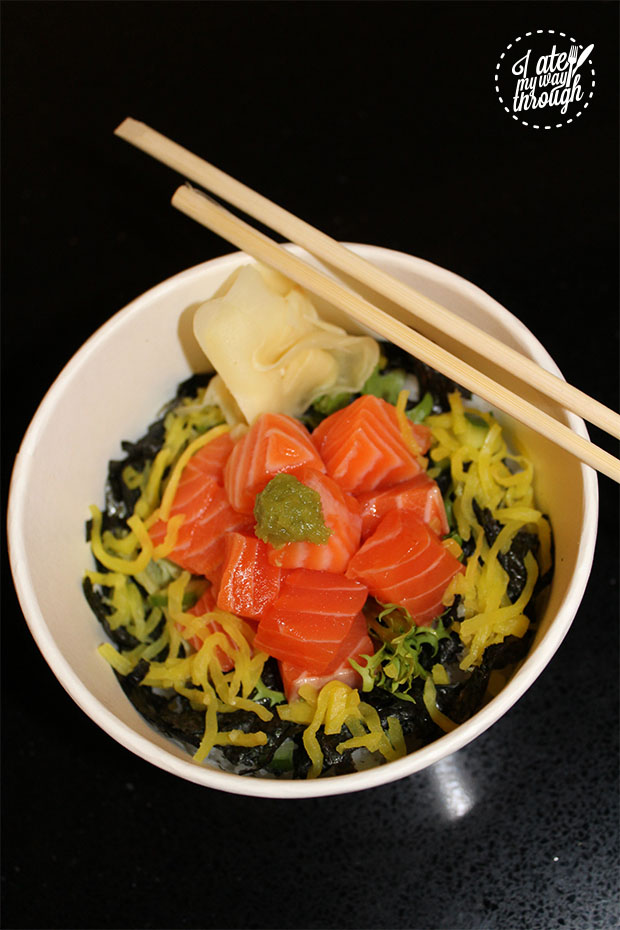 Perfectly filleted and portioned fresh salmon atop nori seaweed and steamed rice.