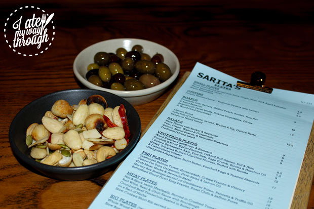 Warm Mixed Nuts and Marinated Olives