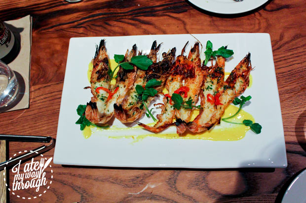 Butterflied Wood Fired King Prawns, Roast Chilli and Saffron Puree