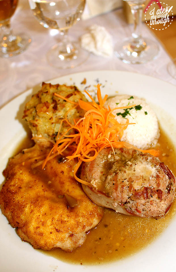 The main course at the wedding was crumbed chicken breast, bacon-wrapped filet mignon and potato rosti and coconut rice.