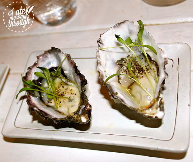 Kagura Pacific Oysters with micro coriander and yuzu sauce.