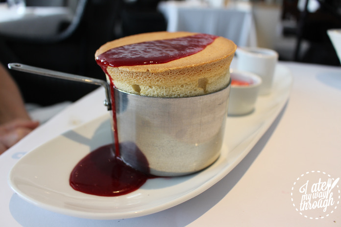 Mango souffle, drizzled with raspberry coulis and served with rapberry sorbet