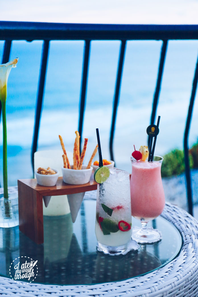 Complimentary bar snacks , Saffron Sunrise cocktail (vodka, Malibu, lime juice, lemon dice, kaffir lime leaves, whole lime, red chilli, soda, Rp 165,000) and Coconut Kiss mocktail (cherry, coconut, pineapple, grenadine, Rp 105,000)