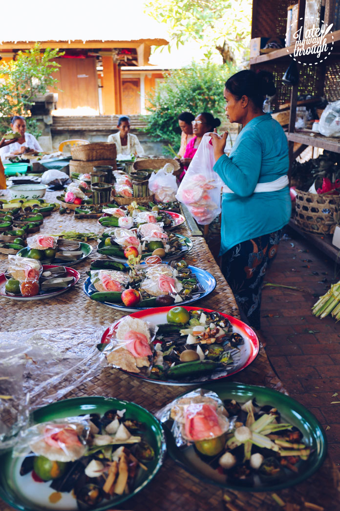 Local Balinese preparing offerings at the temple